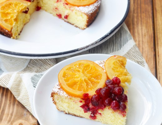 A light and fluffy lemon olive oil cake dressed festively with candied cranberries & orange slices.