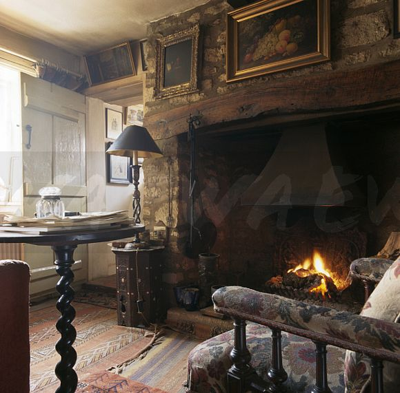 Image Pictures On Wall Above Inglenook Fireplace In Old