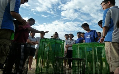 Gathering in front of the iron cages and listened attentively