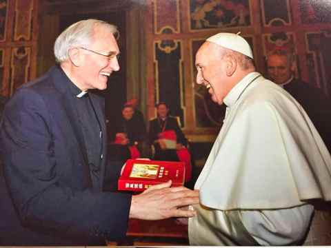 Father Rossa presenting Pope Francis with a Chinese translation of the New Testament.
