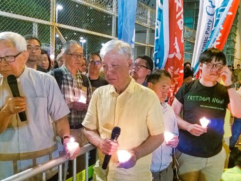 Left to right: Cardinal Zen, Reverend Chu, Lee Wing-tat and Tommy Cheung during a candlelight vigil outside the Lai Chi Kok Reception Centre on April 24.