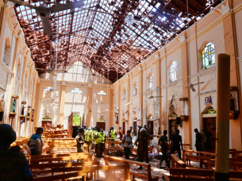 Police examine the devastation after the bombing of St. Sebastian Church in Negombo, Sri Lanka, on April 21. Photo: CNS/Reuters