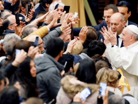 Pope Francis greets people as he arrives for his general audience in Paul VI hall at the Vatican on January 22. Photo: CNS/Reuters