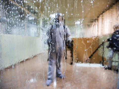 A worker wearing a protective suit in disinfects a bus station in Algiers, Algeria, on March 16. Photo: CNS/Reuters