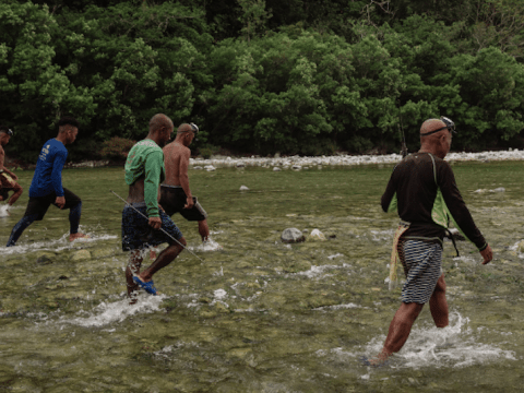 Tribesmen search for food in a river which tribal people claim is being threatened by the building of the Kaliwa Dam. Photo: UCAN/Pau Villanueva