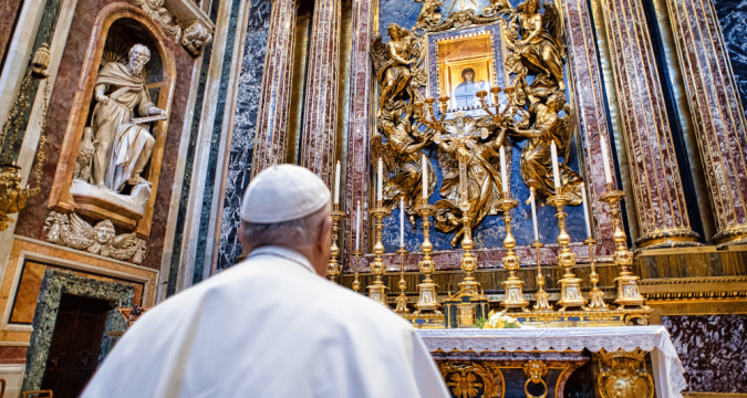 Pope Francis at prayer before the Marian icon, Salus Populi Romani, at the Basilica of St. Mary Major in Rome on March 15. Photo: CNS/Vatican Media