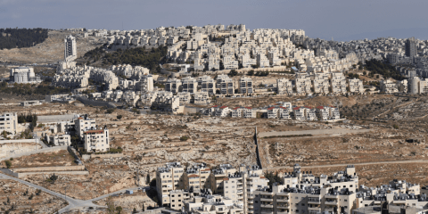 The Israeli settlement of Har Homa on the hillside overlooking houses in Bethlehem in the West Bank. Photo: CNS