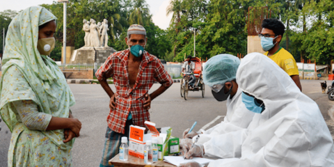 Poor people visit a volunteer group for free medical services in Dhaka during the nationwide shutdown over the Covid-19 pandemic. Photo: UCAN/Piyas Biswas