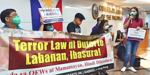 Protesters outside the Philippine Consulate General call for the withdrawal of the anti-terror bill on June 12.