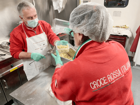 Red Cross volunteers working in a mobile kitchen in Rome's Portuense neighbourhood, preparing pasta for the homeless and the poor on April 3. Photo: CNS