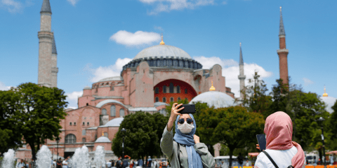 Posing for a selfie in front of Hagia Sophia in Istanbul on July 11. Photo: CNS/Reuters