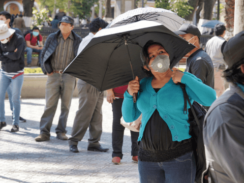 People wearing face masks line up and wait to enter a pharmacy in Cochabamba, Bolivia, on July 21. Photo: CNS/Reuters