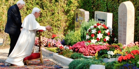 Monsignor Ratzinger and now-retired Pope Benedict, at their parents' grave in Pentling, Germany, in 2006. Photo: CNS/KNA