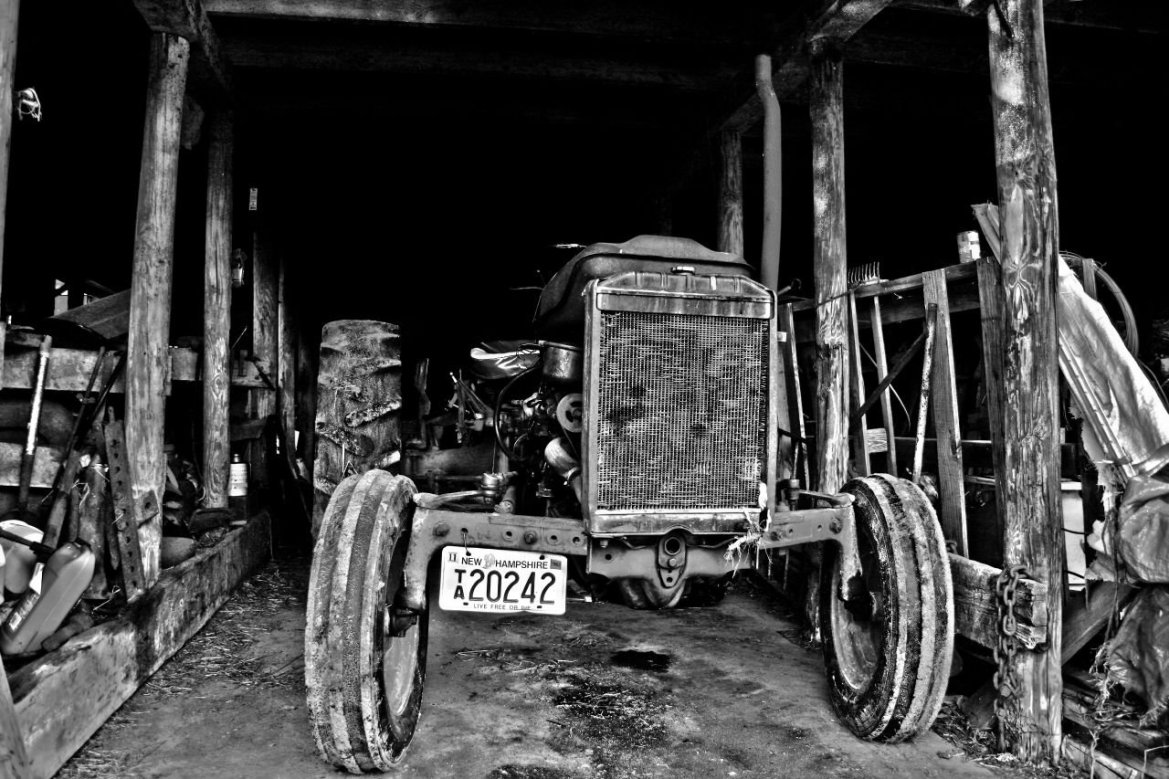 An old tractor in a barn - Photo by Tom Lambert