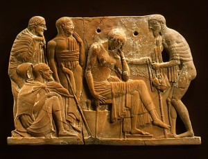 This ancient terracotta plaque shows Odysseus returning to Penelope, surrounded by his father, son, and swineherd.