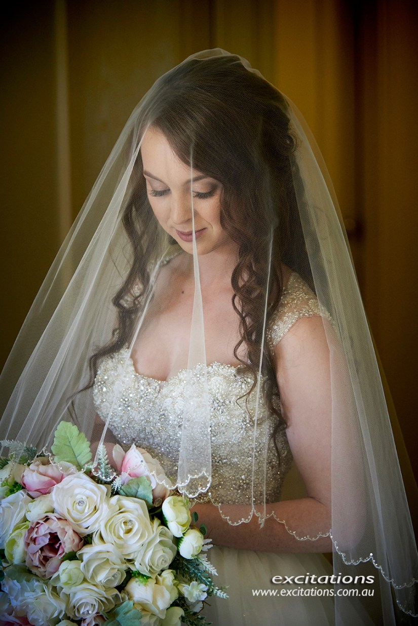 formal bridal portrait of beautiful bride half length under veil. Natural light wedding photos indoors. Photo by excitations photographers mildura.