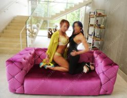 Two lovely Surrey Escorts on a couch
