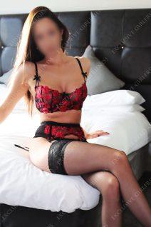 Lara Tempting pose on edge Off Bed