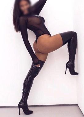 Neena in black pvc thigh length boots
