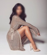 neena looking elegant in a cardigan dress revealing gorgeous legs.