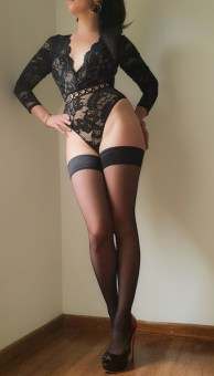 Exclusive escort Molly showing off her long legs. Massage Parlour in Surrey