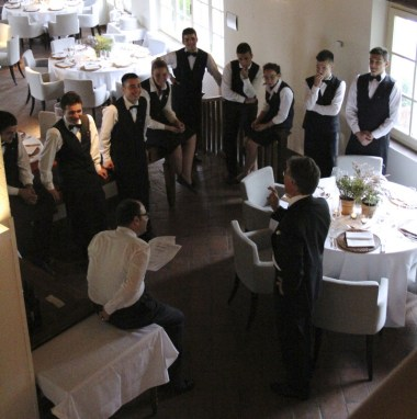 The Maitre briefing all waiters before dinner started.
