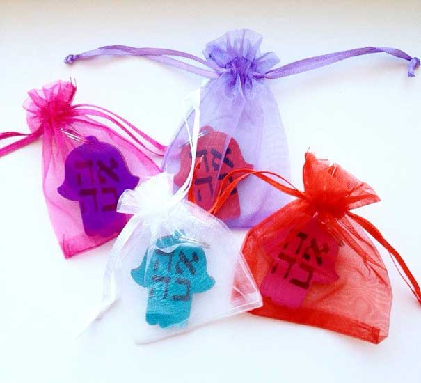 Hamsa wedding favors: the Hamsa or Hand of God is a symbol of good luck.