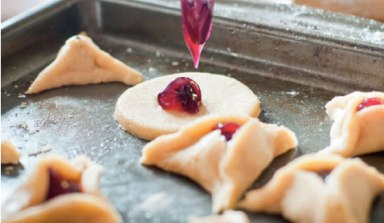 """Hamantaschen"" or ""Haman's ears"" are sweet pastries filled with jam and dry fruits."