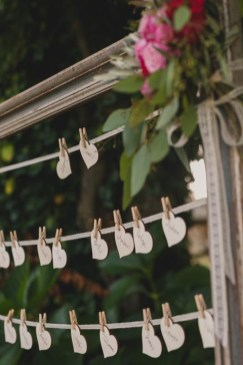 Wooden hearts used as place cards for wedding banquet