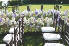 Aisle decoration with white and purple flowers