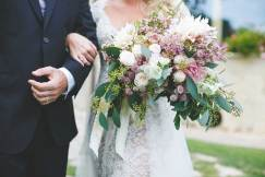 Detail of the bridal bouquet in white, pink and green