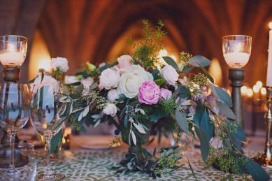 Pink and white flowers with greenery for wedding table