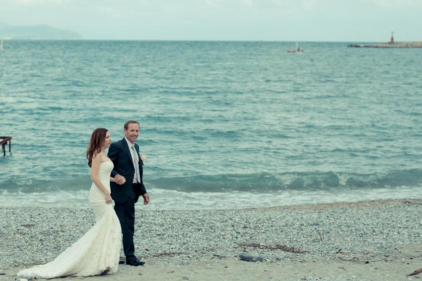 Bride and groom on the beach of the Italian Riviera