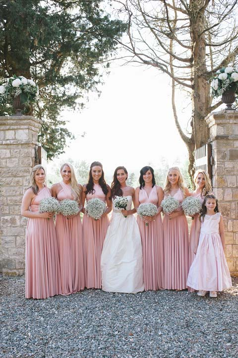 Bride and bridesmaids in the gardens of Castello Il Palagio in Tuscany