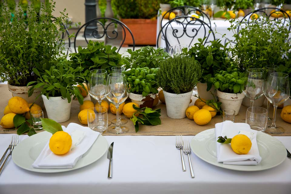 Scented tablescape with fresh herbs and lemons for wedding rehearsal