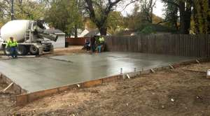 Executive Properties pouring concrete slab for new residential garage