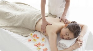 Young woman has received the aroma oil massage