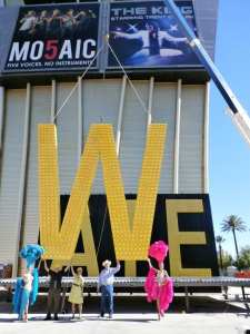 """Westgate Resorts founder and CEO David Siegel, Clark County Commissioner Chris Giunchigliani and LVCVA Chairman Tom Collins ceremoniously lift """"W"""" letter."""