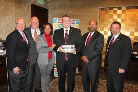 American Heart Association Director of Meetings, Office of Science Operations Jason Ware receives Philadelphia's highest honor, the Liberty Bowl for selecting Philadelphia. From L - R: Jack Ferguson, PHLCVB president & CEO; Greg Stafford, Greater Philadelphia Hotel Association president; Julie Coker Graham, PHLCVB executive vice president; Jason Ware; Philadelphia Mayor Michael A. Nutter and John McNichol, Pennsylvania Convention Center president & CEO.