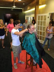 Diagnosed with cancer, Darby's son Cameron cut his back length hair, so it could be donated to Locks of Love.