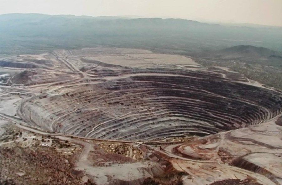 """Paul: The pit, close up, 1.5 miles wide at the top, terraced to the bottom, with huge flat mesas of mine tailings to the north-east (not in photo but visible from Google Earth) also suitable for landings and intergalactic conference center buildings."""""""
