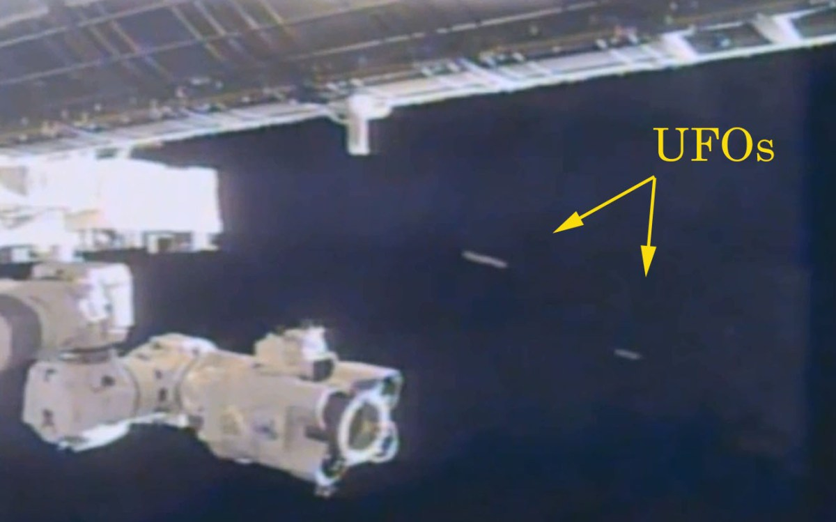 Two cigar shaped UFOs appear near the International Space ...