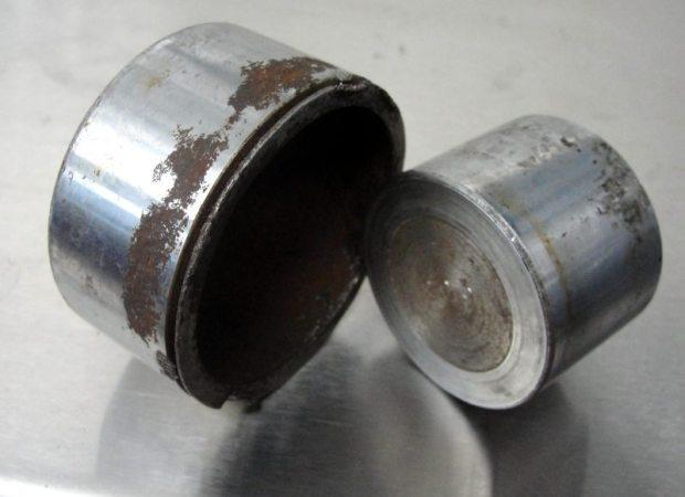 annual brake fluid change prevent rusted brake pistons