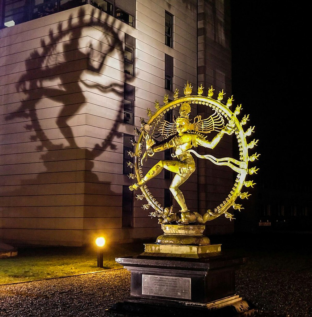 Shiva statue shown outside of CERN at night.