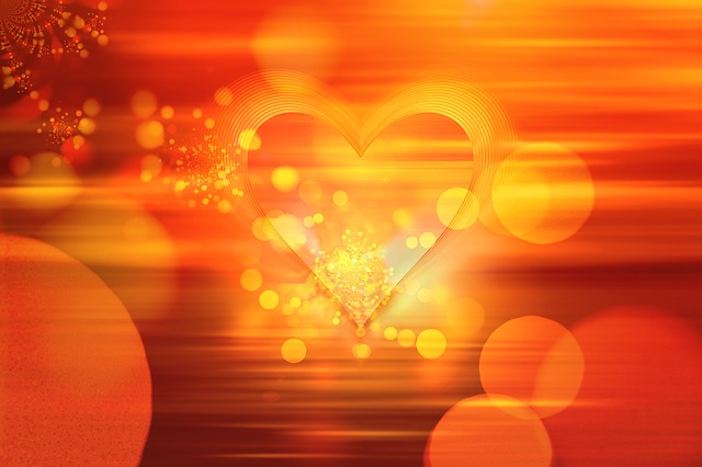 Red and golden heart glowing brightly.