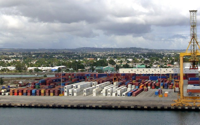 A bird's eye view of a shipping port and shipping containers.