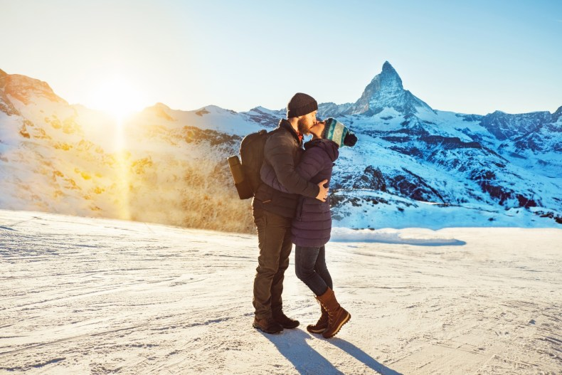 Couple kissing in the snowy Swiss Alps