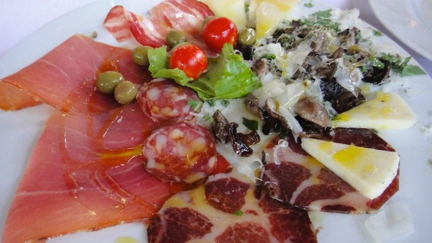 Antipasto with cured meat, cheeses and grilled mushrooms