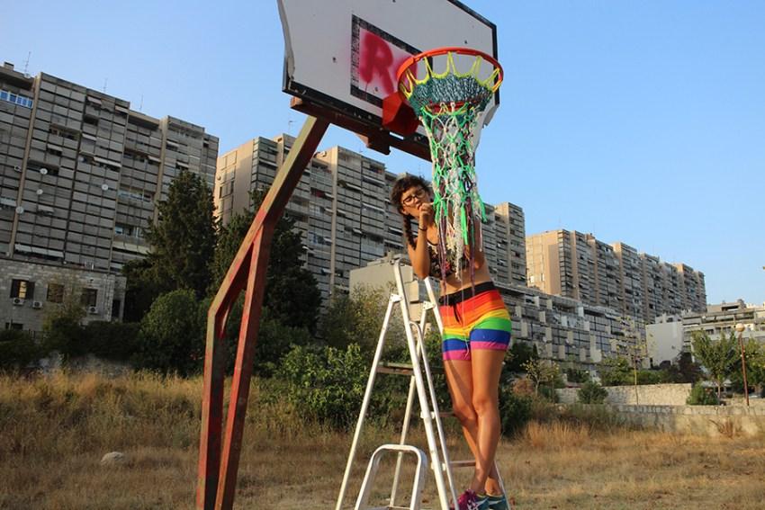 Woman making colorful basketball net
