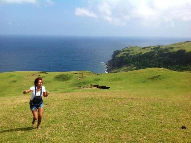 Philippines woman running near the coast
